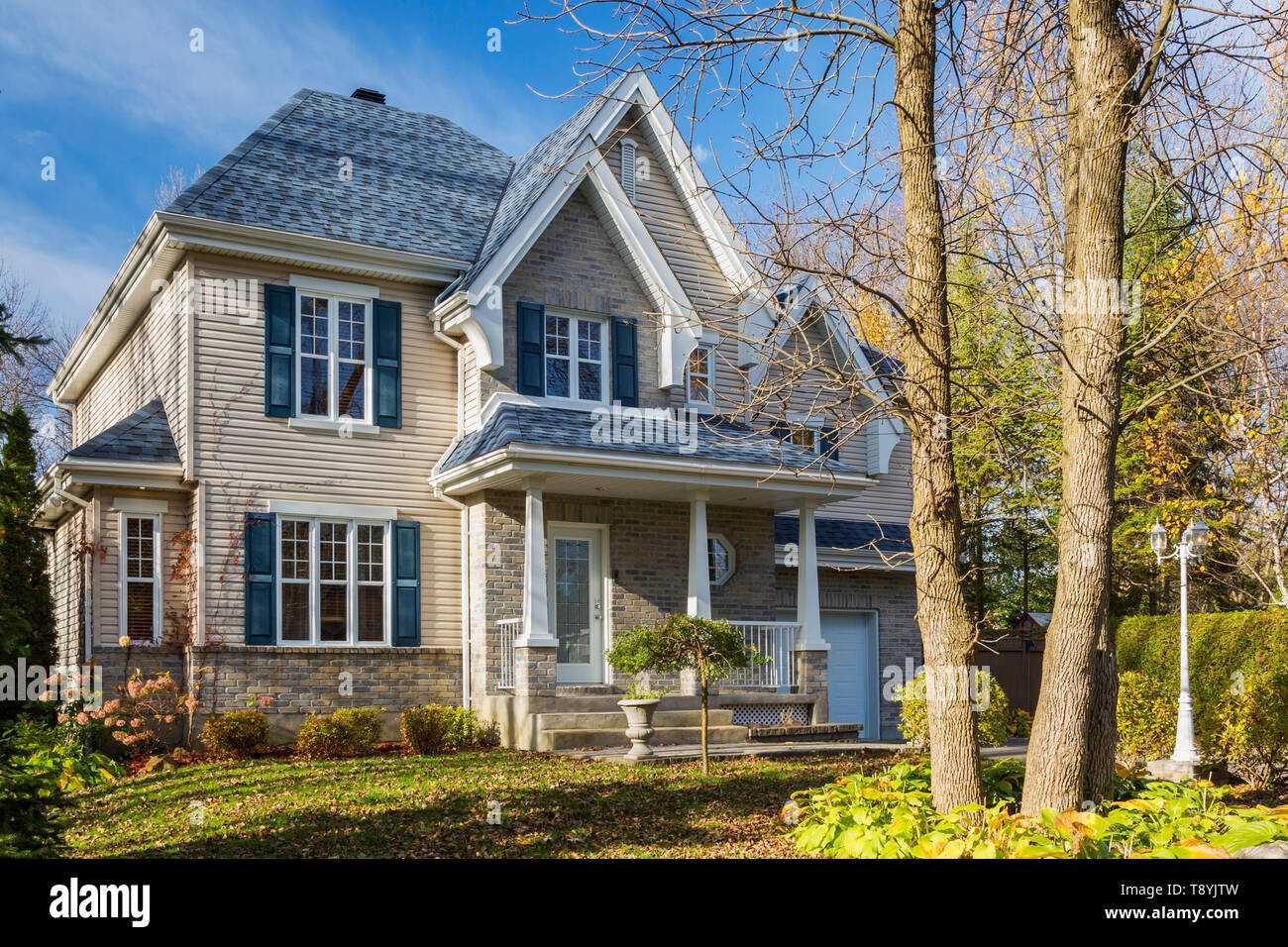 But you can get better fire protection by going instead for simulated wood shingles. Country Tan Brick And Vinyl Cladded Cottage Style House Facade With Blue Trim And Asphalt Shingles Roof In Autumn Quebec Canada This Image Is Property Released Cupr0340 Stock Photo Alamy