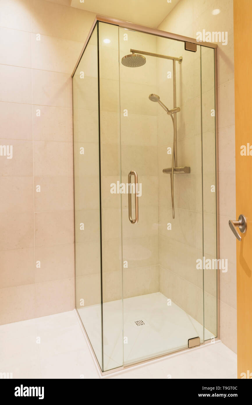 Clear Glass Shower Stall In Guest Bathroom With White Marble Floor And Walls Inside A Luxurious Renovated Condominium Unit In An Old 1910 Multistoried Residential Heritage Building Montreal Quebec Canada This Image
