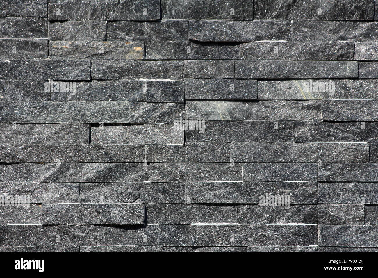 https www alamy com rows of natural dark stone tiles on family house wall texture background wallpaper on warm sunny day image258741438 html