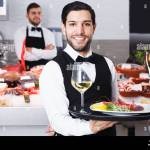 Cheerful Bearded Waiter Standing With Serving Tray In Seafood Restaurant Stock Photo Alamy
