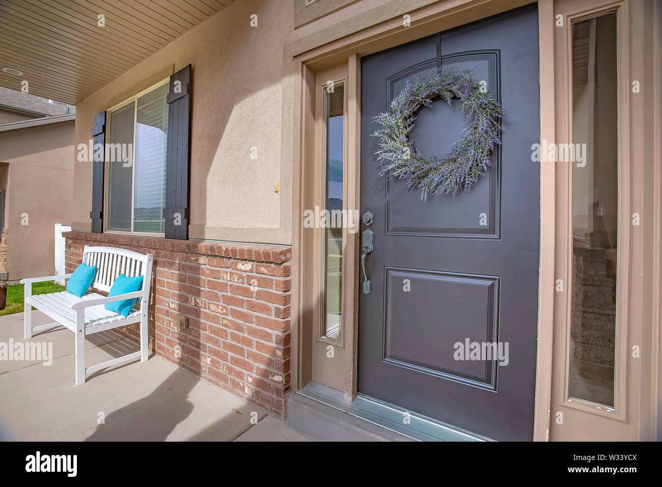 Porch And Front Door With Wreath And Sidelights Viewed On A