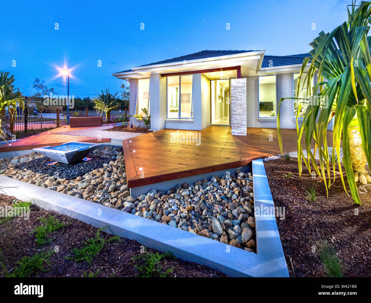 https www alamy com elegant house exterior with plantation wooden patio floor lights and house entrance image260659148 html