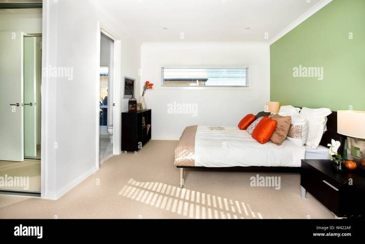 Simple Bedroom Design Belongs To Luxury House Or Hotel Indicating The Classic Way Of Decoration With White And Green Walls The Floor Has A Thin Carpe Stock Photo Alamy