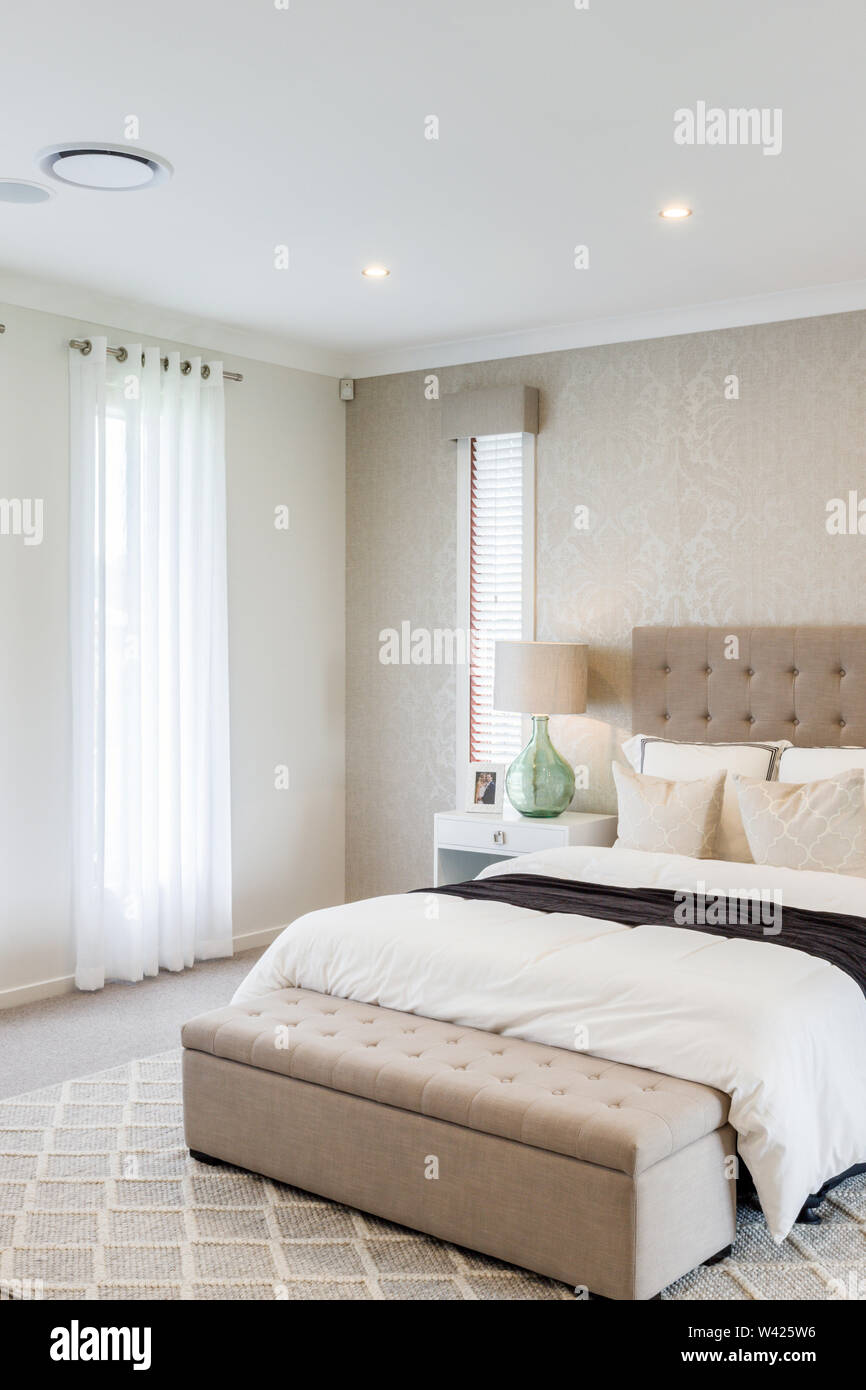 https www alamy com a contemporary bed set with a bedroom bench and a side table with a green lamp to add a touch of color image260662674 html