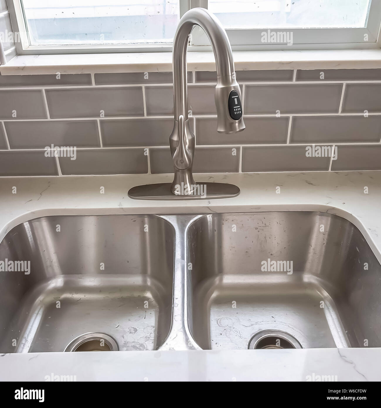 https www alamy com square frame double bowl stainless steel sink undermounted on the white kitchen countertop image262119029 html