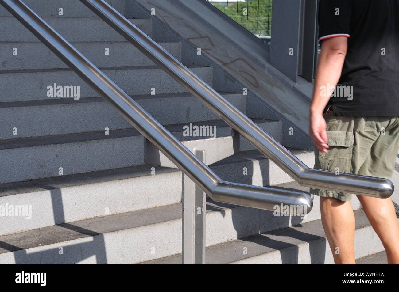 Concrete Steps With Railing Of Stainless Steel Leading To | Railing For Concrete Steps | Stairwell | Retaining Wall | Concrete Slab Detail | Commercial | Safety