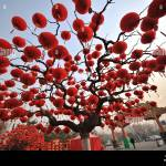 Red Lantern Shaped Decorations Hang On A Tree Ahead Of A Temple Fair To Celebrate Upcoming Chinese Lunar New Year Or Spring Festival At Ditan Park In Stock Photo Alamy
