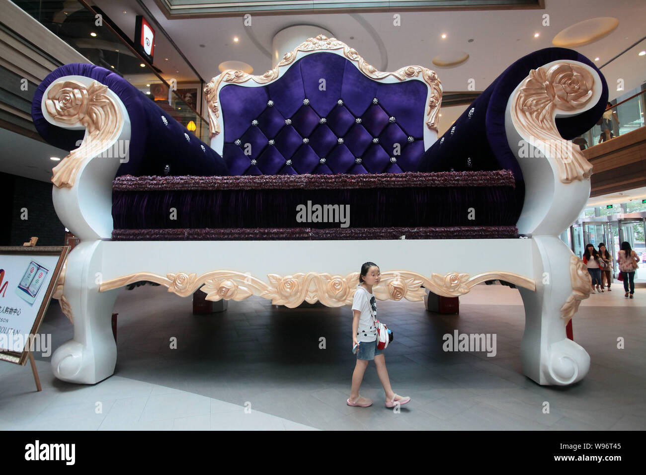 https www alamy com shoppers walk past the worlds biggest sofa at a mall in shanghai china 24 august 2012 a giant sofa has become a hotspot and attraction in downtow image263838069 html