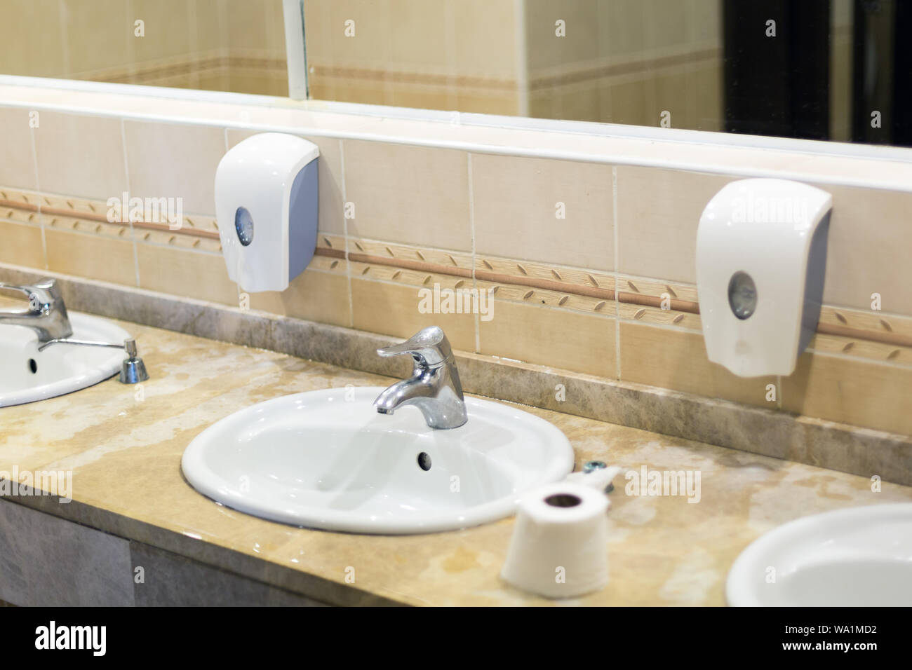 https www alamy com washbasin washbasin faucet with water and liquid soap in the hotel toilet image264340078 html
