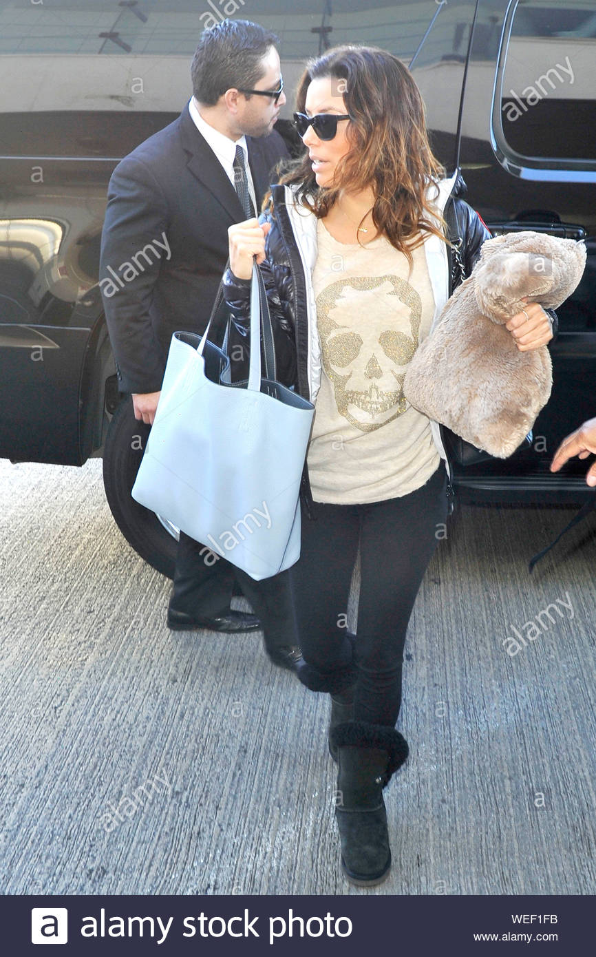 https www alamy com los angeles ca eva longoria prepares for take off at lax carrying her favorite travel pillow the brunette actress looked cute in a skull t shirt black jacket black leggings matching her ugg boots and natural beauty with no make up on akm gsi january 5 2014 image267091199 html