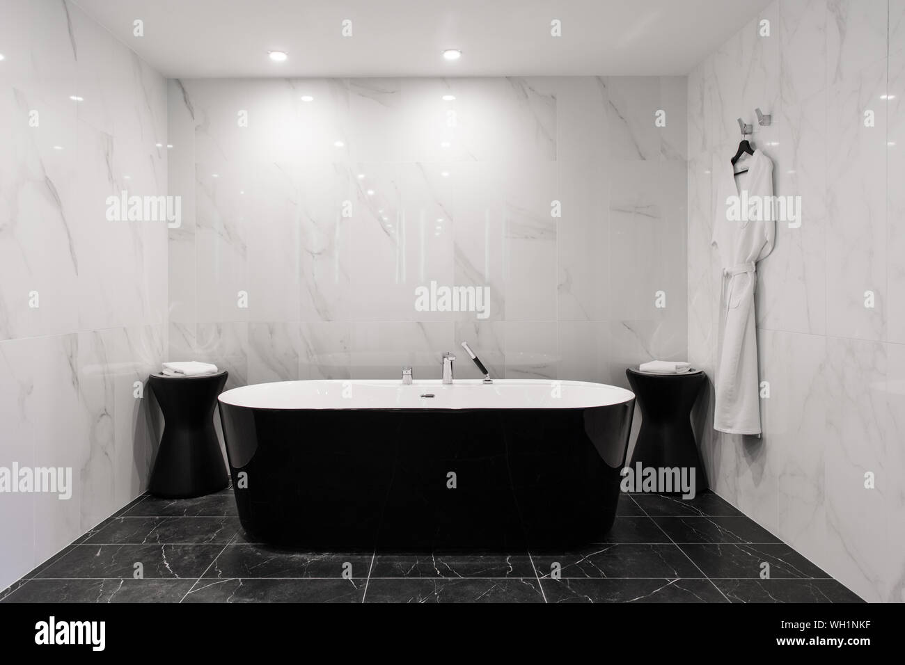 https www alamy com freestanding black bathtub stylish minimalist black and white loft style bathroom bath washstand walls with marble tiles image268643635 html