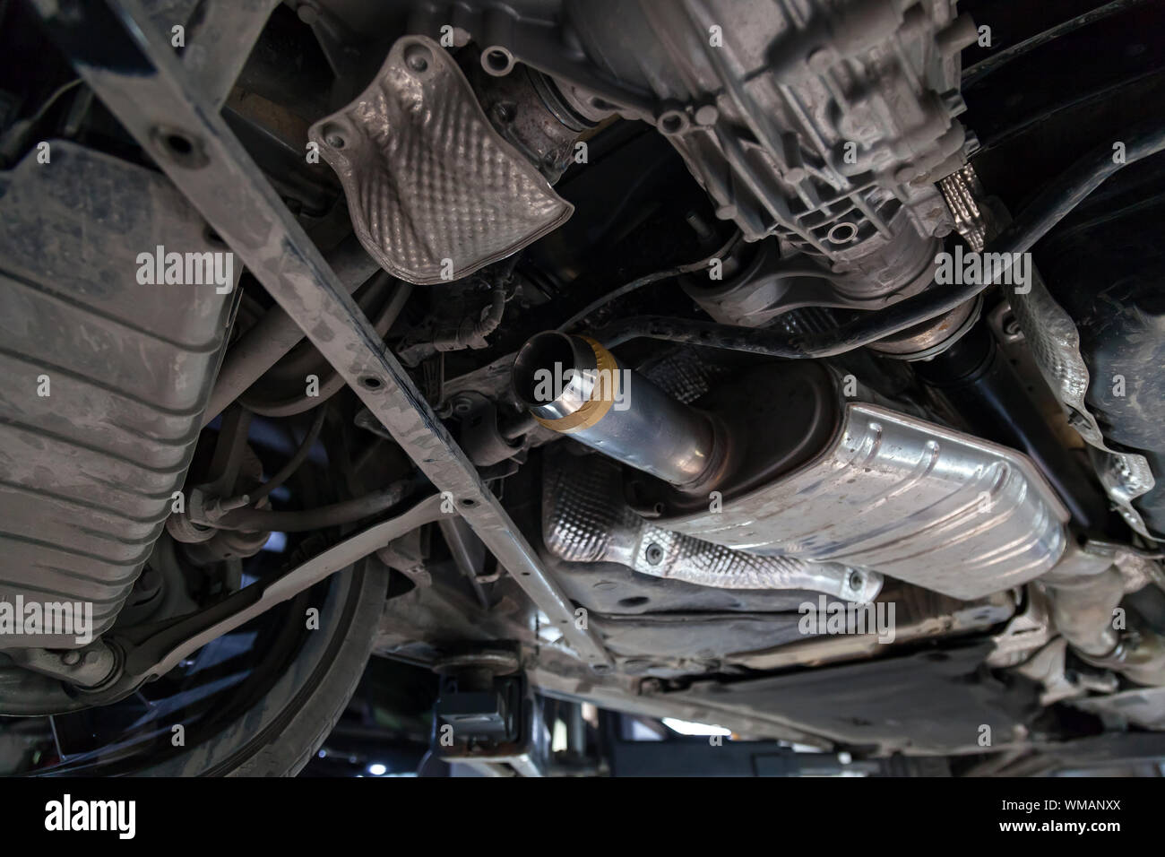 https www alamy com close up on the part of the bottom of the car from the front of the exhaust pipe and the catalyst disassembled during the repair in the workshop auto image270685378 html