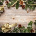 Christmas Decoration Fir Tree Garland Frame And A Gold Ribbon Gift Box Against Wood Natural Background Copy Space Stock Photo Alamy