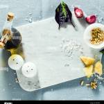 Marble Cutting Board And Spices On A Linen Blue Tablecloth Olive Oil Pine Nuts And Basil Copy Space Stock Photo Alamy
