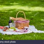 Healthy Outdoor Summer Or Spring Picnic Spread Out On A Rug