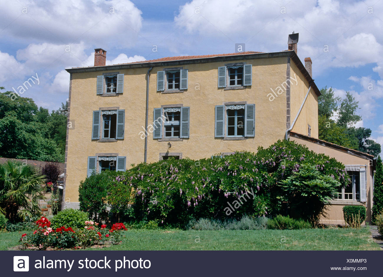 Exterior Of French Country House With Blue Shutters Stock