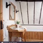 Basin In Pine Washstand In Small White Beamed Attic Bathroom