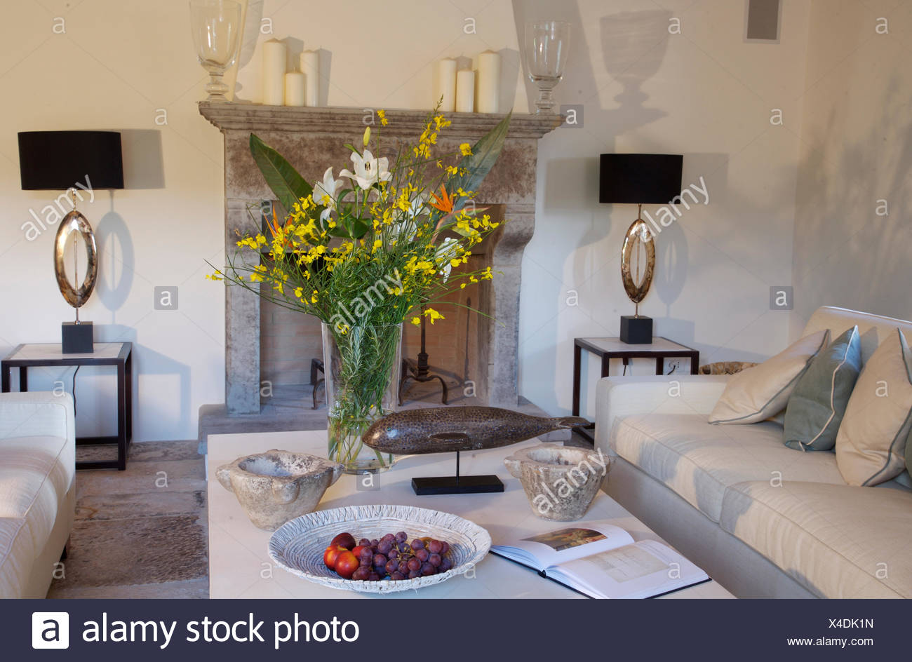 https www alamy com modern white sofas and coffee table with arrangement of summer flowers in italian country living room image278124833 html