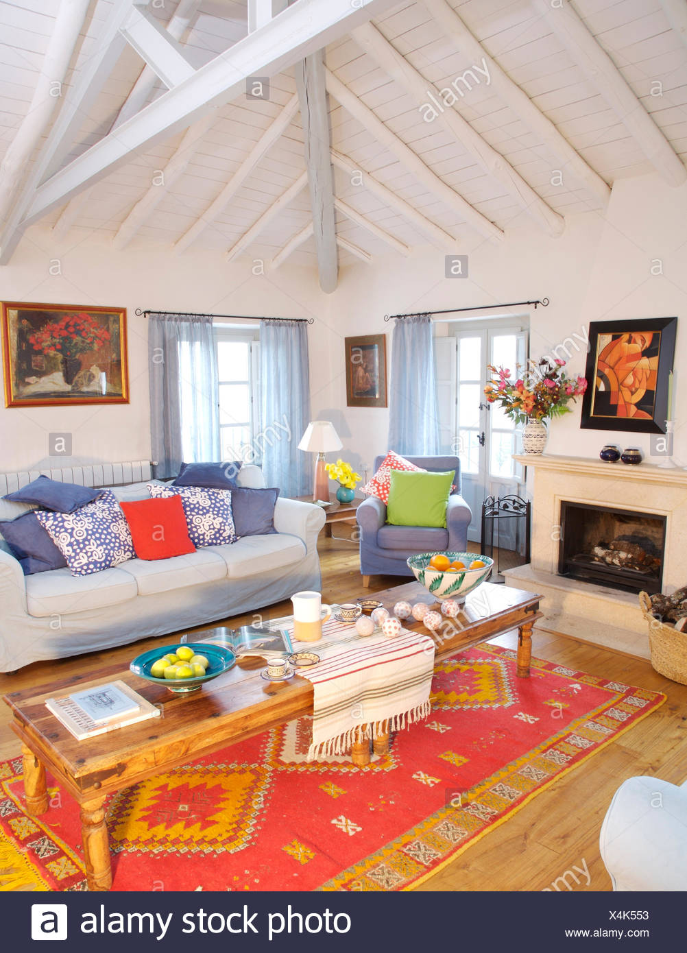 https www alamy com rustic wooden coffee table on red ethnic rug in spanish country living room with white painted beamed ceiling image278245663 html