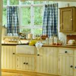 Blue White Checked Curtains On Window Above Sink In Cottage Kitchen Extension With Pale Yellow Fitted Units Stock Photo Alamy