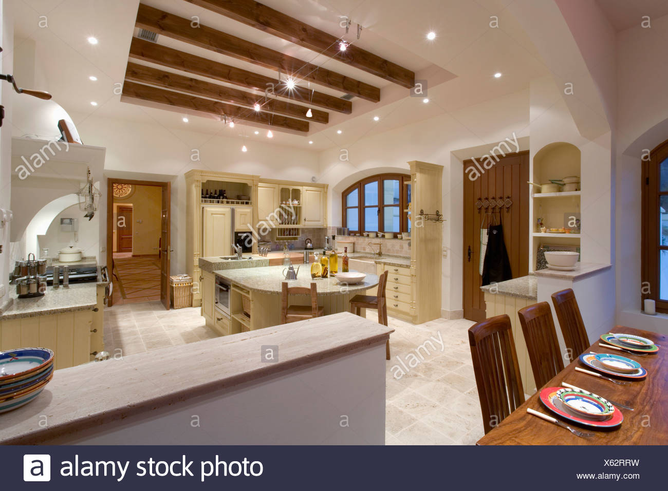 https www alamy com large kitchen dining room in modern spanish villa with lighting on ceiling with beamed recess image279116429 html