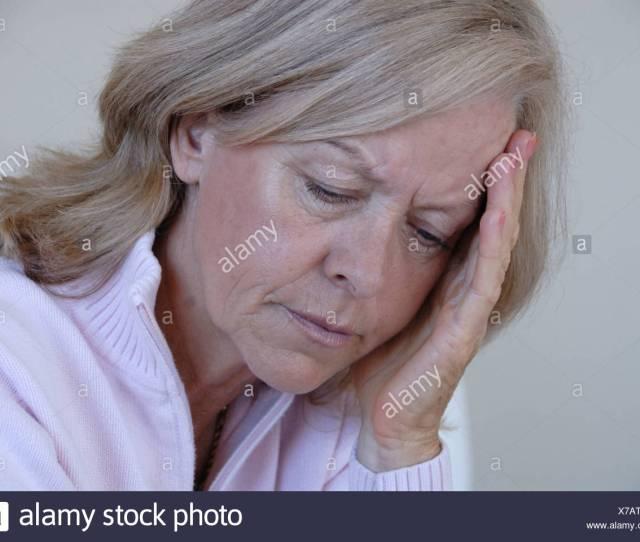 Woman Senior Seniors Mature Matures Medicine Portrait Bad Mood Moody Depressive Headache Pain Serious Adu