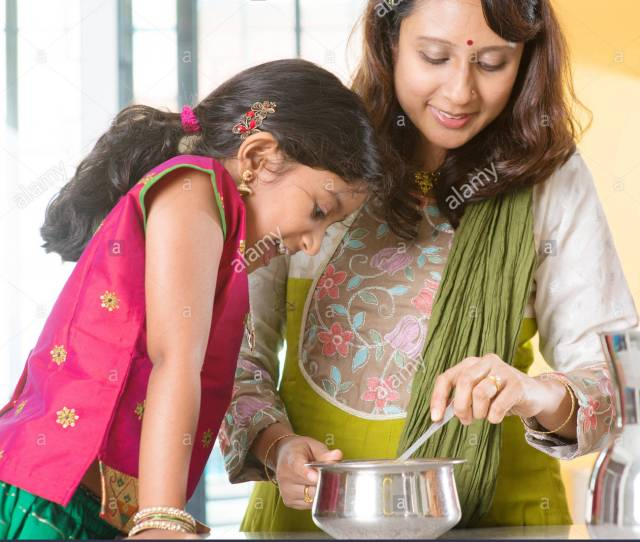 Asian Family Cooking Food Together At Home Indian Mother And Child Preparing Meal In Kitchen