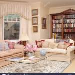 Cream Sofas Piled With Cushions In Traditional Neutral