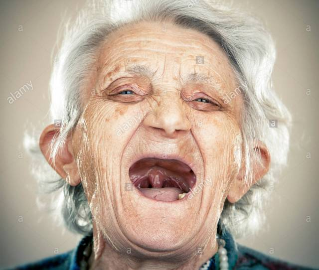 Portrait Of An Elderly Lady Laughing Out Loud Stock Image