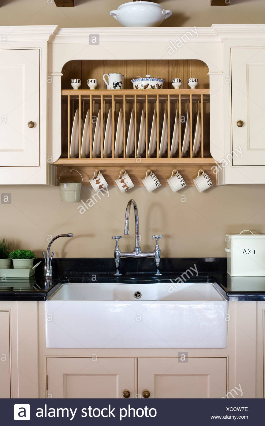 https www alamy com fitted plate rack in fitted cream cupboard above white butlers sink in country kitchen image283024994 html