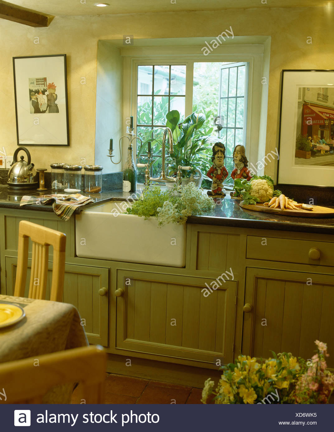 White Belfast Sink Below Window In Country Cottage Kitchen With Pale Green Fitted Units Stock Photo Alamy