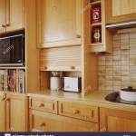 Close Up Of Toaster In Kitchen Cupboard With Roll Up Wooden Door Stock Photo Alamy