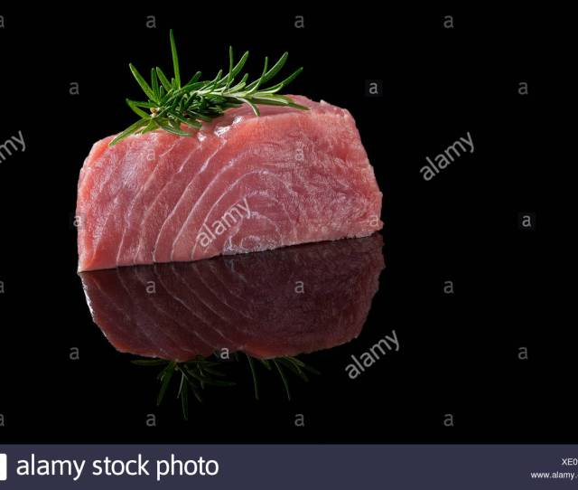Tuna Steak Isolated On Black Background Raw Fresh Tuna Steak With Rosemary Herbs On Black