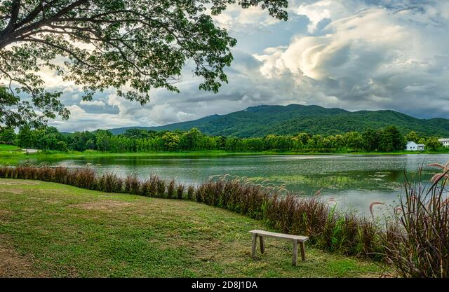 Your sunset mountain lake stock images are ready. Panoramic View Of The Lake Forest And Mountain Before Sunset A Bench Beside The Lake With A Mountain And Sky View Sunset View With Beauty Of Nature Stock Photo Alamy