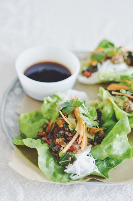 Thai beef lettuce wraps with rice noodles topped with carrots and cucumbers