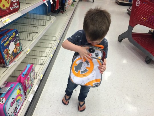 picking out his lunchbox