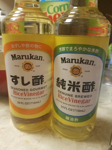 Bottles of Marukan Seasoned Rice Vinegar on the left, and Marukan (Plain) Rice Vinegar on the right