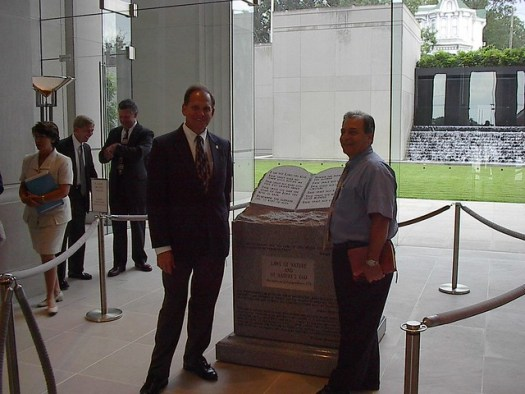 Roy Moore with his Ten Commandments monument in Montgomery, 2002