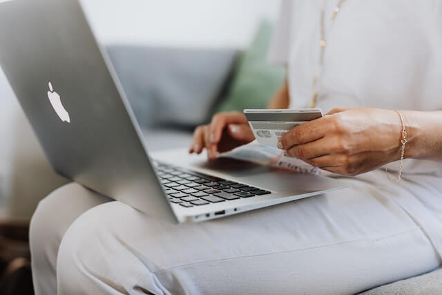Close-up of someone making an online purchase with a card