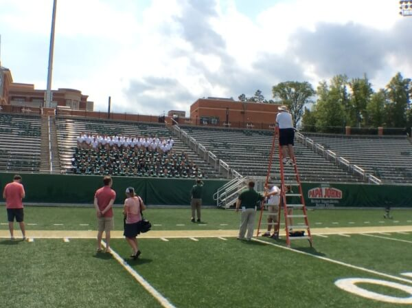 Sam Roberts, on the ladder, takes this year's team photo at  Jerry Richardson Stadium