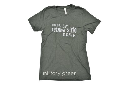 "military green cycling t-shirt that reads ""keep the rubber side down"""