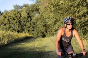 model on a bike wearing Keep the Rubber Side Down tank top