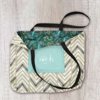 tote bag: taupe with blue, aqua, and white chevrom exterior and deep teal, bright teal, and orange floral print interior