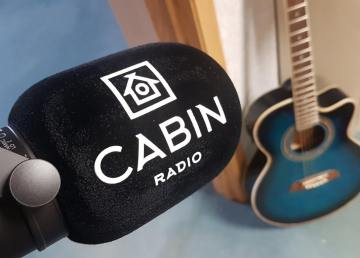 Cabin Radio microphone with guitar