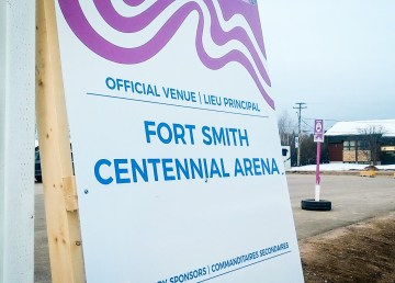 A large sign welcomes visitors to Fort Smith's Centennial Arena for the Arctic Winter Games
