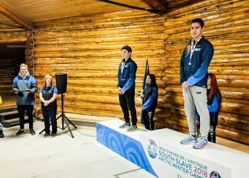 Braeden Picek, right, and Dalton McLeod stand on the podium after winning ulus at the 2018 Arctic Winter Games