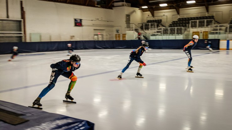 Team NT speed skaters warm up at the 2018 Arctic Winter Games