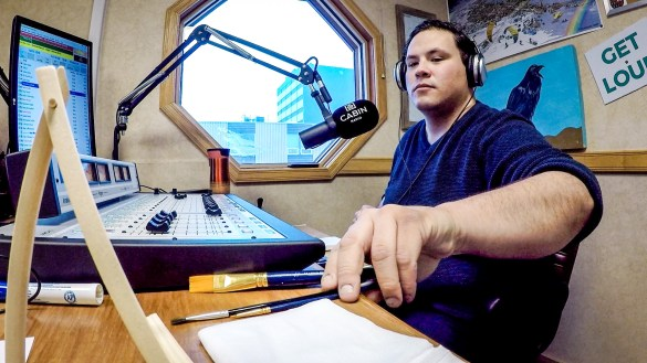 Jesse Wheeler prepares to paint inside Cabin Radio's Studio 1