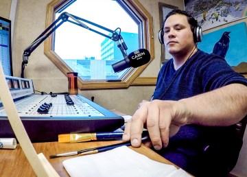 Jesse Wheeler prepares to paint inside Cabin Radio's Studio 1