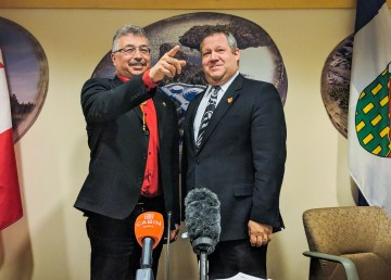 Northwest Territories MP Michael McLeod, left, and territorial health minister Glen Abernethy at a news conference on April 11, 2018